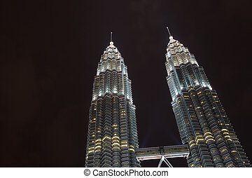 Lighted Petronas Towers Silhouetted Against Black Sky -...