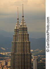 Twin Petronas Towers Rise into Dusk Sky in Kuala Lumpur...