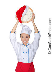 Happy asian chef with clock and Christmas hat isolated in...