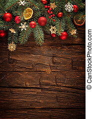 Christmas fir tree with decoration on a wooden board. Free...