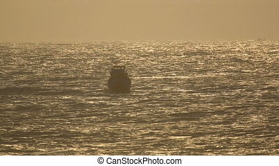 Fishing boat in ocean - Fishing boat rocking on the waves in...