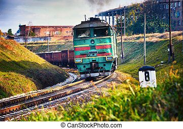 goods train - The diesel train with wagon goes on a curve...