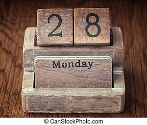 Grunge calendar showing Monday the twenty eighth on wood...