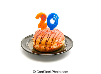 donut with twenty years birthday candle on white