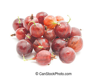 heap of red gooseberries on white - heap of red gooseberries...