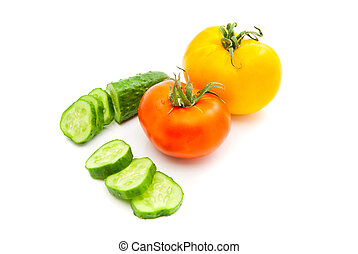 cucumber and two tomatoes - cucumber and pair of tomatoes on...