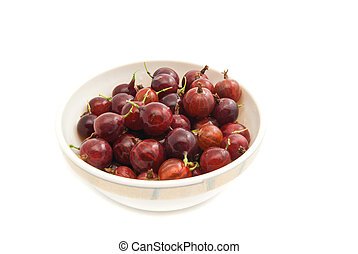 gooseberries on a glass dish - tasty red gooseberries on a...