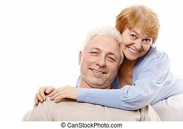 Happy spouses of advanced age on a white background
