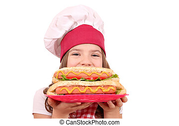 little girl cook with hot dog