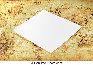 white paper on a old world map