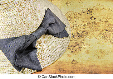 vintage hat on a old world map