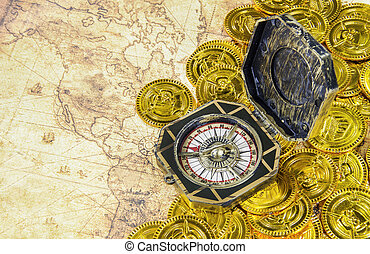 compass and pirate golden coin on a old world map