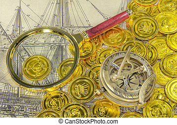 magnifying glass and compass on a pirate gold coin