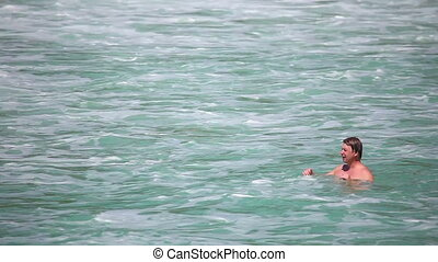 Waves od Andaman sea - A man relaxes in waves of the Andaman...