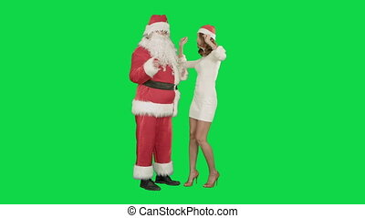 Christmas woman with santa claus dancing on a Green Screen Chrome Key
