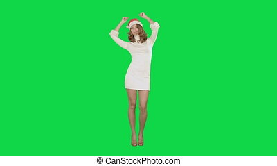 Christmas girl in santa hat dancing happy laughing having fun on a Green Screen Chrome Key