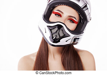 The girl in the helmet. - Beautiful girl with makeup in a...