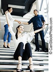 Group of business people shaking hands on stairs