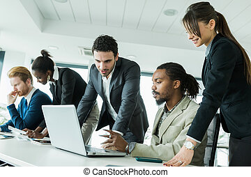 Colleagues brainstorming at a desk in on office