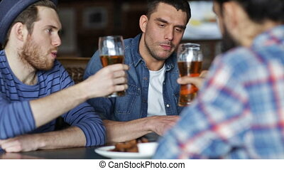 happy male friends drinking beer at bar or pub - people,...