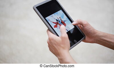 couple hands with tablet pc viewing photos at home - people,...