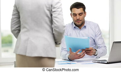 businessman with papers and secretary in office - business,...