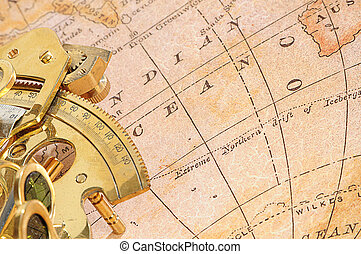 navigation device on a background an old map