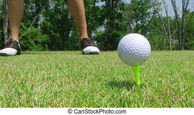 Golfer Teeing Off With Driver - Close-up of golfer teeing...