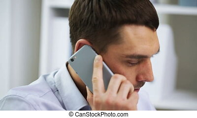 businessman with laptop calling on smartphone - business,...