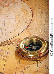 old-fashioned compass on a background an old map
