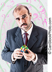 Confused businessman - a puzzled businessman trying to solve...
