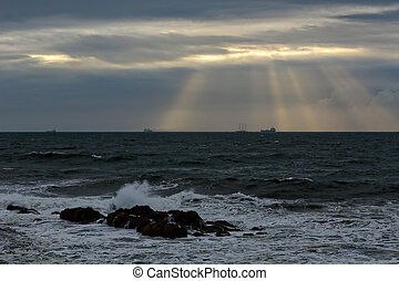 Autumn moody seascape with sunbeams
