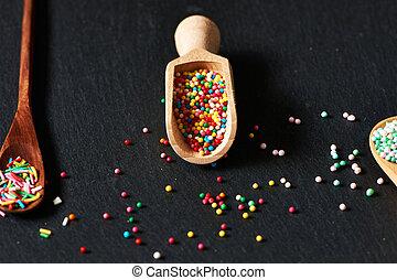 Sugar sprinkle dots on slate background