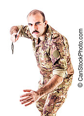 Combat soldier - a soldier wearing camouflage clothing...