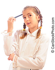 schoolgirl holds a pen at a forehead - thoughtful schoolgirl...
