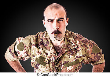 Drill Sergeant with whistle - a soldier or drill sergeant...