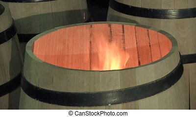 manufacturing wine barrels - heating the corolla to...