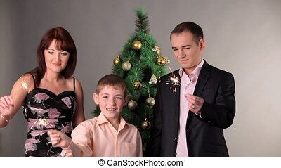 Happy Family With Sparkles On Christmas