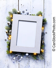 art Christmas background with fir branches and frame on the old wooden board in vintage style