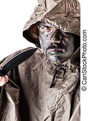 Assassin soldier - a soldier wearing a poncho or raincoat...