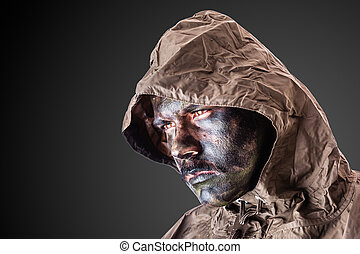 Dramatic soldier - a soldier wearing a poncho or raincoat...