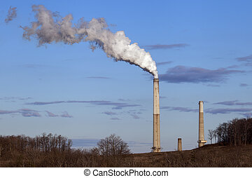 Smoke Stacks - Smoke stacks against a bright blue sky.