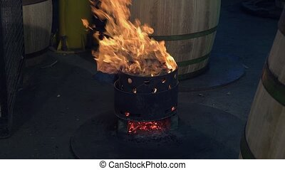 manufacturing wine barrels - heating the barrel to complete...