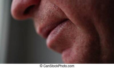 Man of average years mouth talking. - Man of average years...