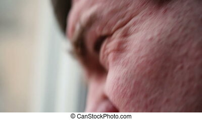 Man of average years a facial expression when he speaks. -...