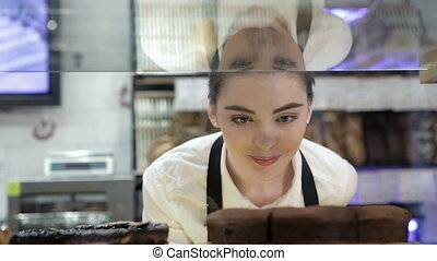 Girl view through the glass display case - Portrait of a...