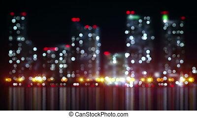 blurred skyscrapers on shore loop