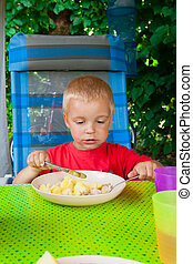 Boy eating - Cute blond boy eating lunch in the camp