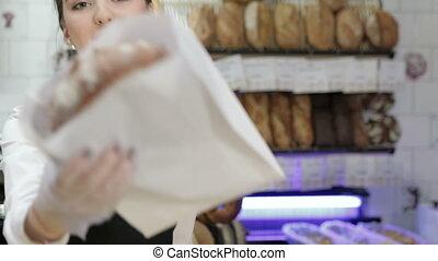 Seller giving the fresh baked - Portrait of a seller giving...