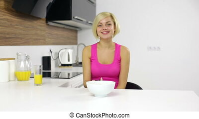 woman watching tv remote control eat corn flakes - woman...